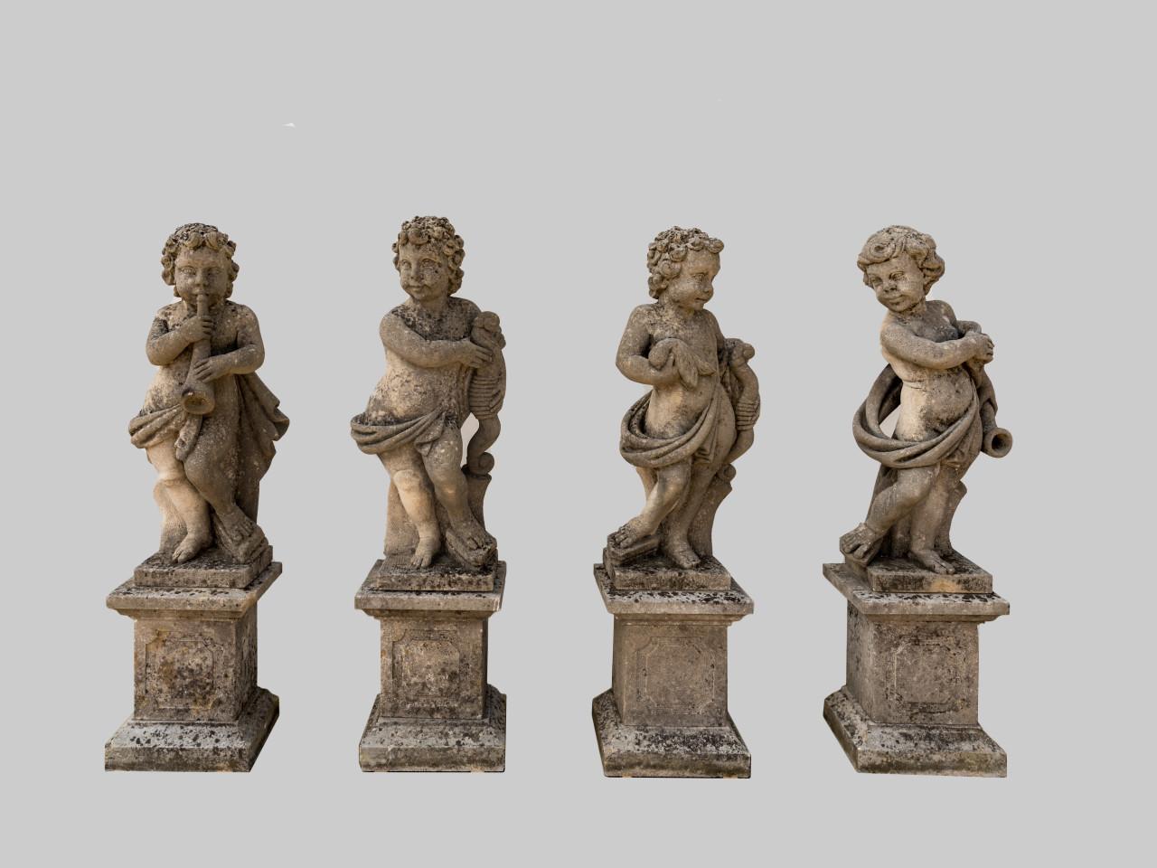 Gruppo di 4 putti in pietra di Vicenza